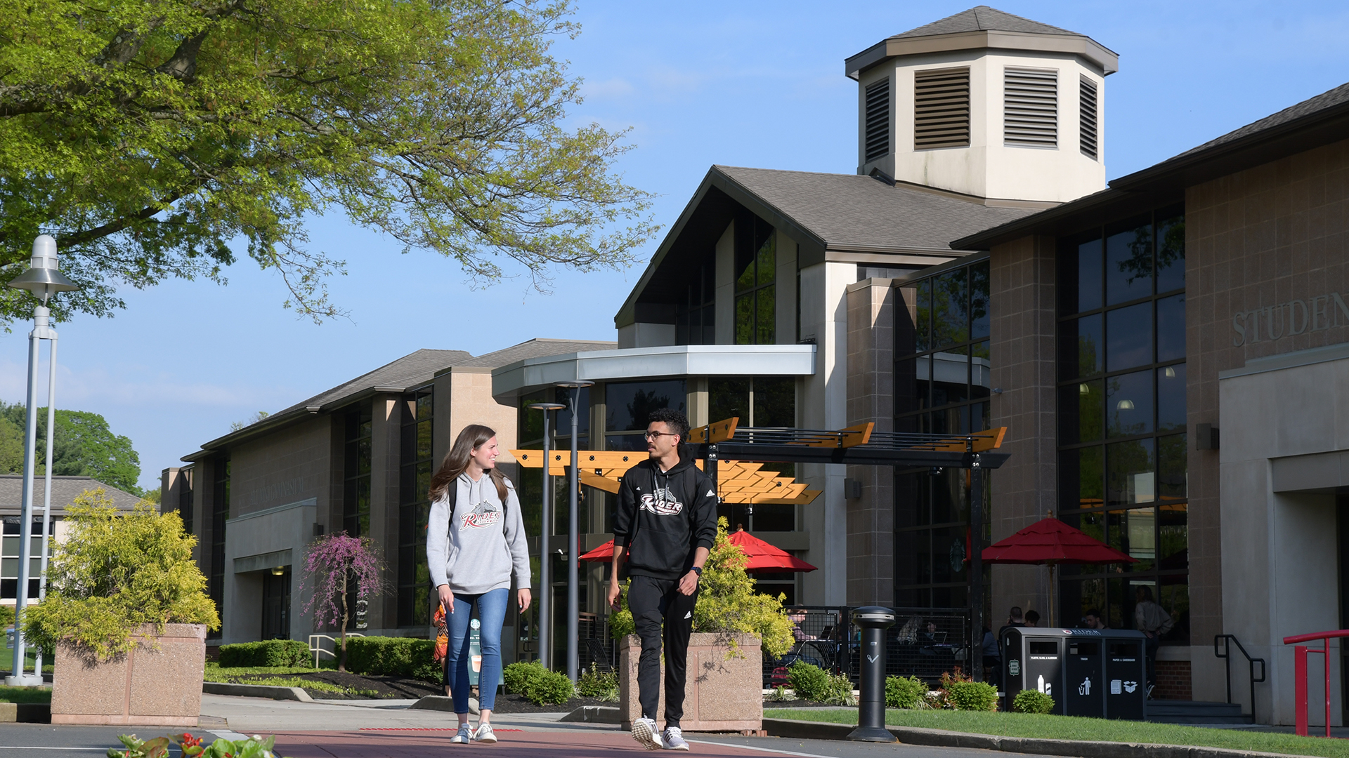 Two students walk near Student Recreation Center