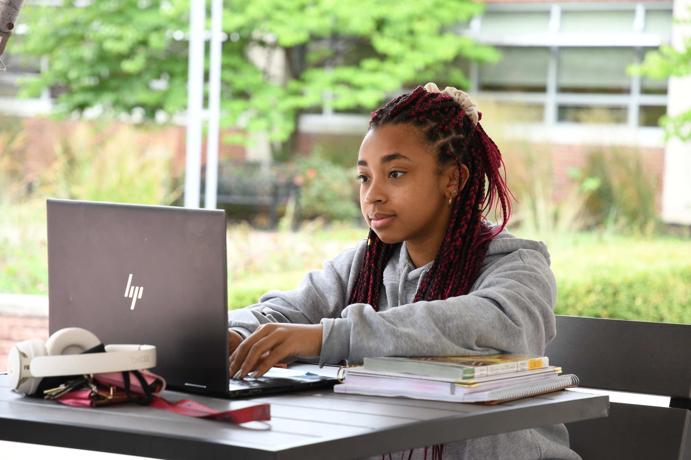 Student working outside on laptop