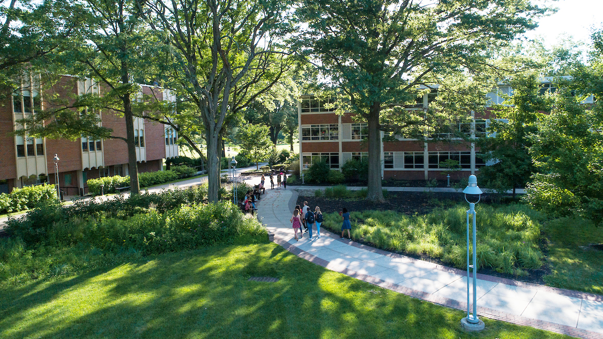 Students walk across academic quad